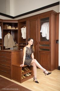 A Dressed Up Woman Sitting Down In Her Custom Closet Custom Closets Alpha Closets & Company Inc, 6084 Gulf Breeze Pkwy