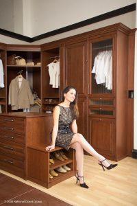 A Dressed Up Woman Sitting Down In Her Custom Closet Custom Closets Alpha Closets & Company Inc, 6084 Gulf Breeze Pkwy