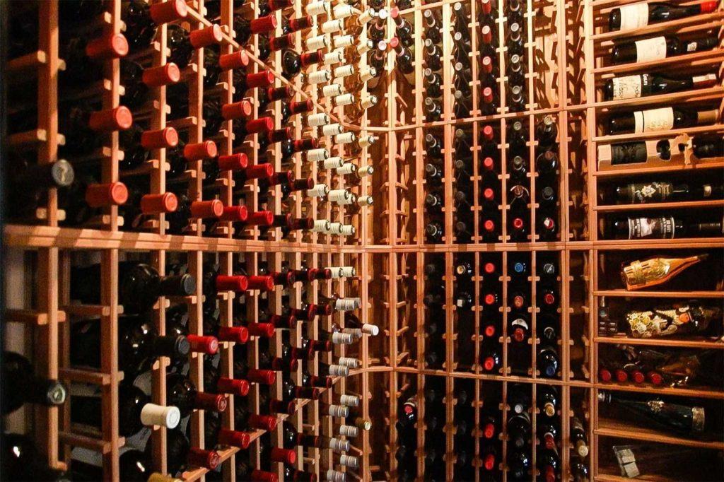 Brown Wine Racks Filled With Wine Custom Wine Racks Alpha Closets Company Inc, 6084 Gulf Breeze Pkwy, Gulf Breeze, Fl 32563 (850) 934 9130