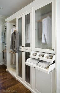 Grey Jacket On A Hanging Rack In White Organized Closet Custom Closets Alpha Closets & Company Inc, 6084 Gulf Breeze Pkwy