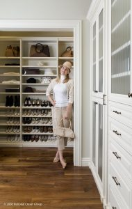 Lady Smiling For The Camera In Her White Organized Closet Custom Closets Alpha Closets & Company Inc, 6084 Gulf Breeze Pkwy