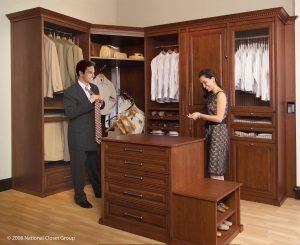 Man And Woman Inside Their Organized Custom Closet Custom Closets Alpha Closets & Company Inc, 6084 Gulf Breeze Pkwy