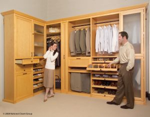 Man And Woman Inside Their Organized Custom Closet Custom Closets Alpha Closets Company Inc, 6084 Gulf Breeze Pkwy