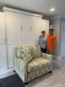 Sofa With Lady And Guy Next To It In Fornt Of A White Murphy Bed Murphy Beds Alpha Closets & Company Inc, 6084 Gulf Breeze