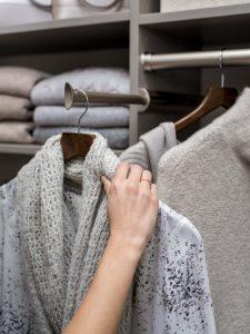 Ladies Hand Putting A Shirt On A Closet Rack Custom Closets Alpha Closets Company Inc, 6084 Gulf Breeze Pkwy, Gulf Breeze, Fl 32563 (850) 934 9130